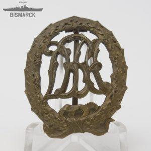 Insignia DRA en bronce